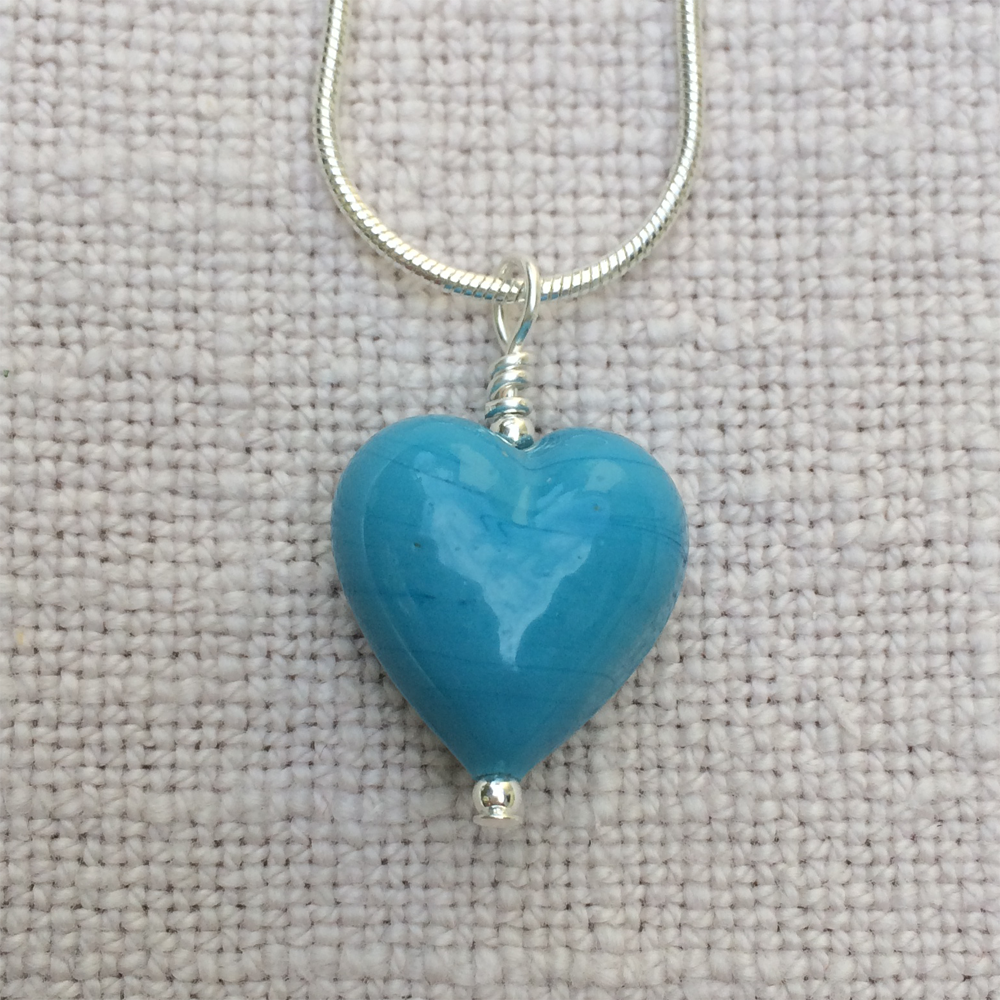 Necklace with turquoise (blue) pastel Murano glass small heart pendant on silver snake chain