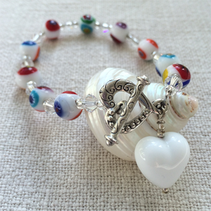 Bracelet with white pastel Murano glass mosaic sphere beads, Swarovski© crystals & heart charm
