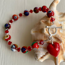 Bracelet with red Murano glass mosaic beads, Swarovski© crystals and heart charm