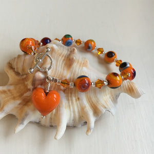 Bracelet with orange pastel Murano glass mosaic sphere beads, Swarovski© crystals & heart charm