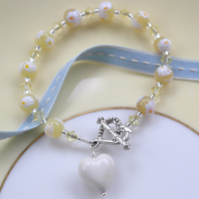Bracelet with pale yellow Murano glass marguerite beads, Swarovski© crystals and heart charm