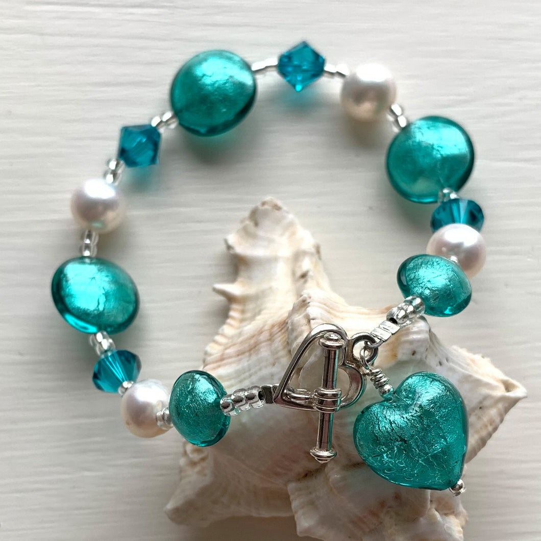 Bracelet with teal (green, jade) Murano glass beads, Swarovski© crystals, pearls, heart charm