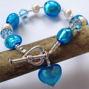 Bracelet w/ turquoise (blue) Murano glass mixed beads, Swarovski© crystals, pearls & heart charm