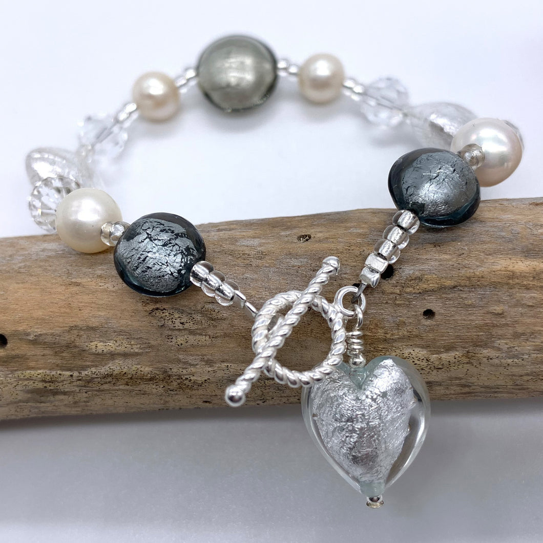 Bracelet with grey and clear crystal Murano glass beads, Swarovski© crystals, pearls, charm