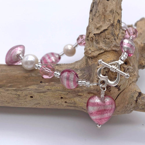 Bracelet with candy stripe pink Murano glass beads, Swarovski© crystals, pearls & charm