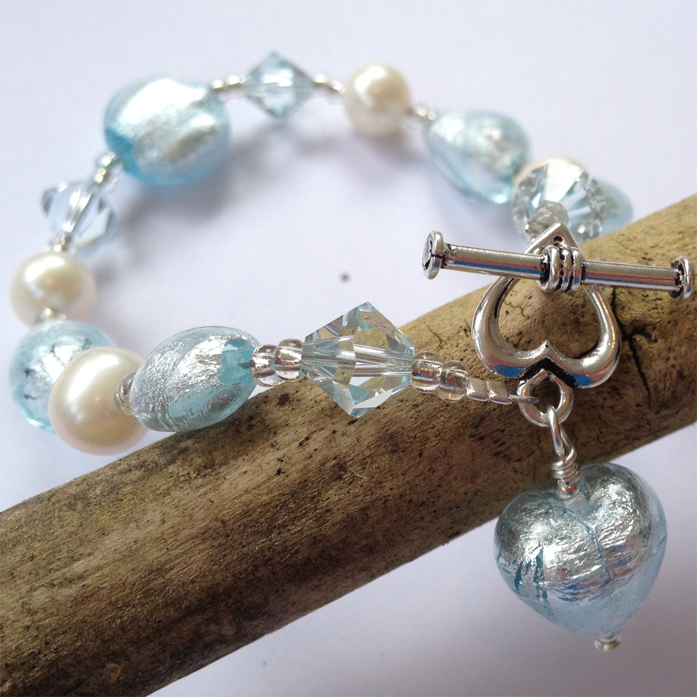 Bracelet with aquamarine (blue) Murano glass beads, Swarovski© crystals, pearls & charm