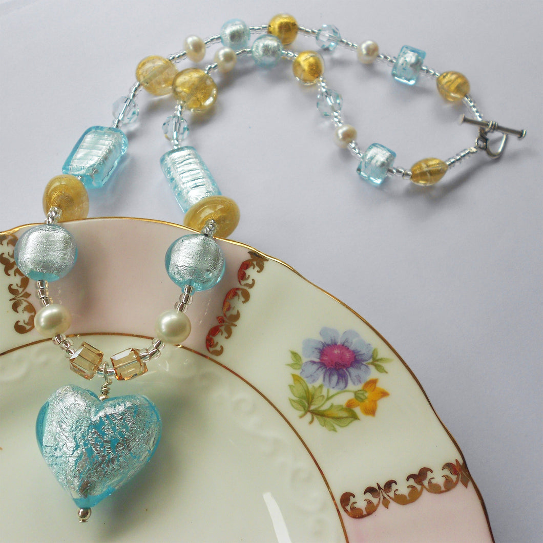 Necklace with aqua (blue), gold Murano glass beads, Swarovski© crystals, pearls, heart