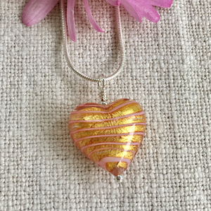 Necklace with pink spiral and gold Murano glass medium heart pendant on silver chain