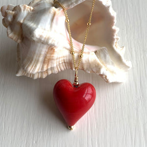 Necklace with red pastel Murano glass medium heart pendant on gold chain