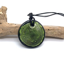 Necklace with light green and silver on black Murano glass near circular large flat pendant