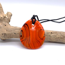 Necklace with orange pastel Murano glass near circular large flat pendant
