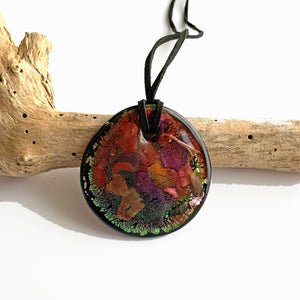 Necklace with shades of green and ruby on black Murano glass circular large flat pendant