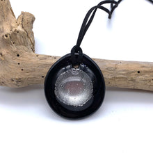 Necklace with clear crystal and silver on black Murano glass near circular large dome pendant