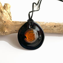 Necklace with amber (brown) and silver on black Murano glass circular dome pendant
