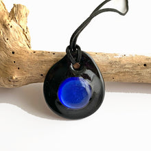 Necklace with turquoise (blue) and silver on black Murano glass near circular dome pendant