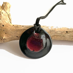 Necklace with dark amethyst and silver on black Murano glass near circular dome pendant