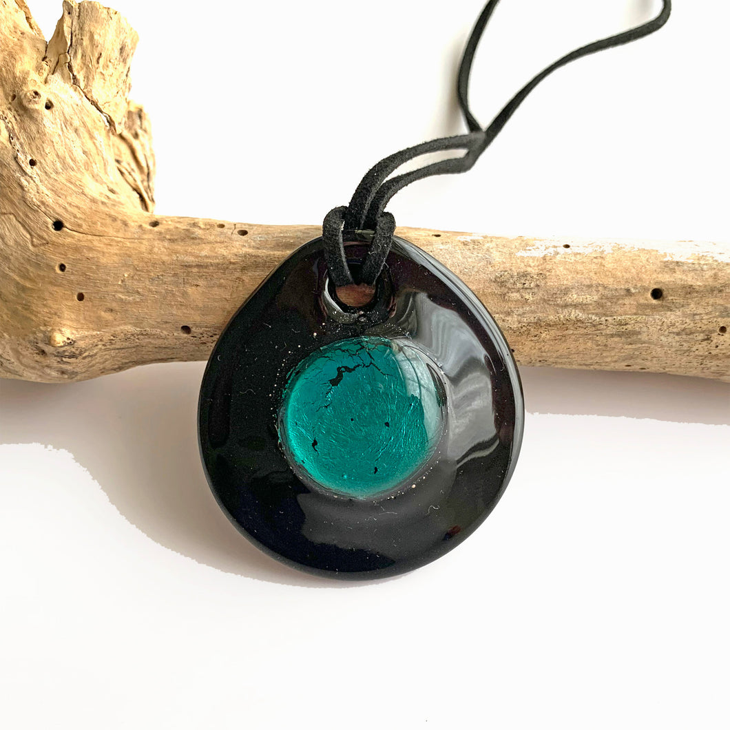 Necklace with teal (green) and silver on black Murano glass near circular dome pendant