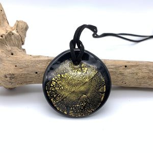 Necklace with clear crystal and gold on black Murano glass near circular large flat pendant
