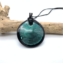 Necklace with teal (green, jade) & silver on black Murano glass near circular large flat pendant