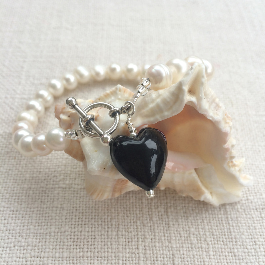 Bracelet with black pastel Murano glass small heart charm on white freshwater pearls