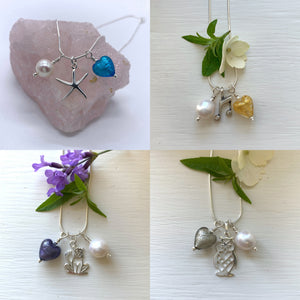 Three charm necklace in silver with aquamarine (blue) heart and *20 charm options*