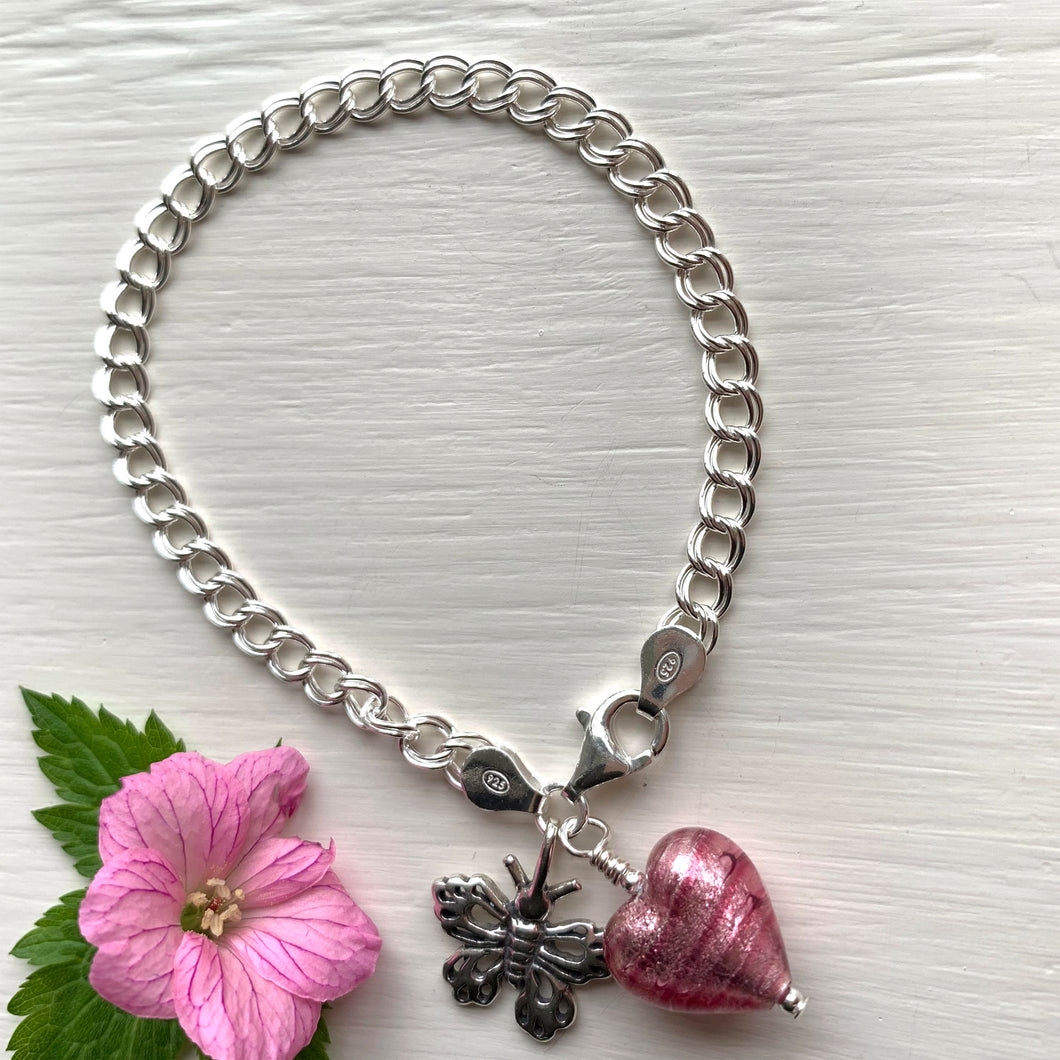 Bracelet w/ candy stripe pink Murano glass small heart & butterfly charms on Sterling Silver curb chain