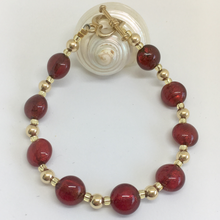 Bracelet with red (it. rosso) Murano glass mini lentil beads on gold beads and clasp