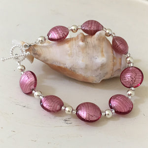 Bracelet with rose pink (cerise) Murano glass small lentil beads on silver beads and clasp