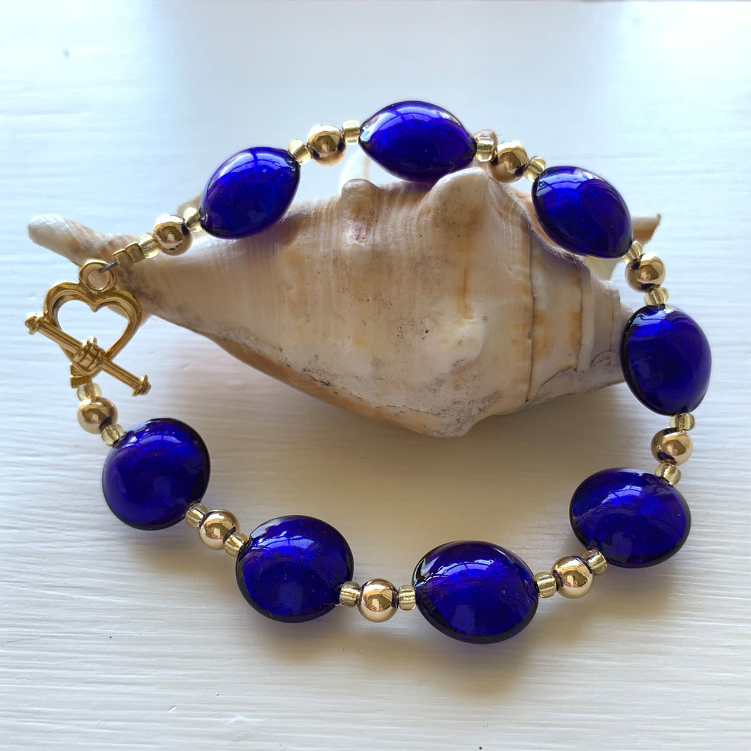 Bracelet with dark blue (cobalt) Murano glass small lentil beads on gold beads and clasp