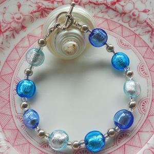 Bracelet with shades of blue Murano glass mini lentil beads on silver beads and clasp