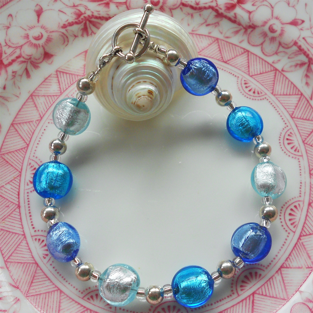 Bracelet with shades of blue Murano glass mini lentil beads on Sterling Silver beads & clasp