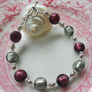 Bracelet with dark amethyst (purple) and grey Murano glass mini lentil beads on silver