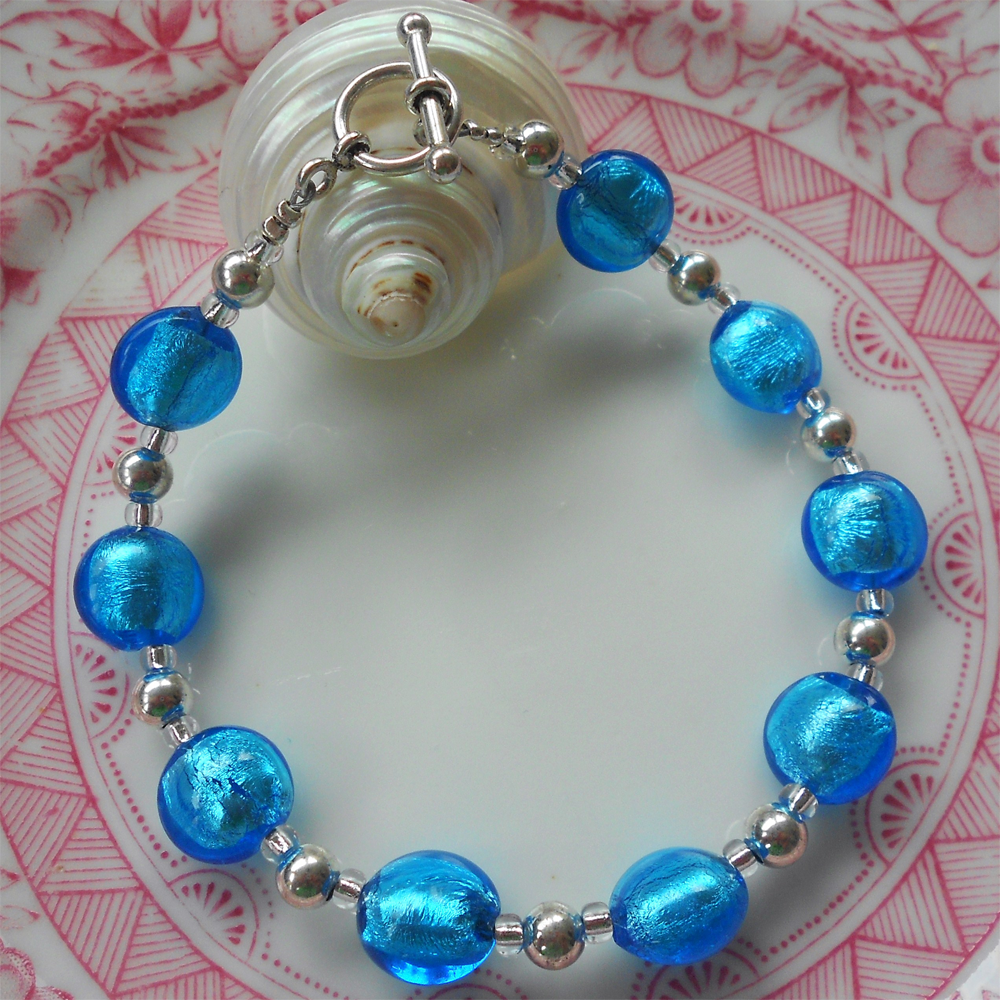 Bracelet with turquoise (blue) Murano glass mini lentil beads on silver beads and clasp