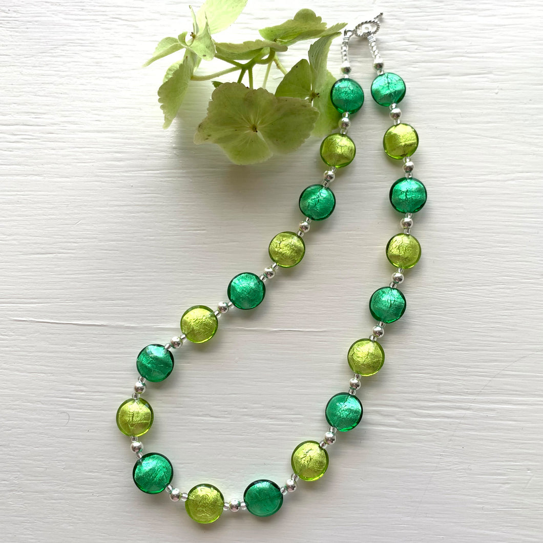 Necklace with dark and light green Murano glass small lentil beads on silver