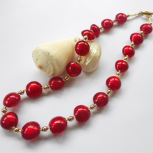 Necklace with red (it. rosso) Murano glass small lentil beads on gold beads and clasp