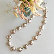 Necklace with champagne (peach, pink) Murano glass small lentil beads on silver