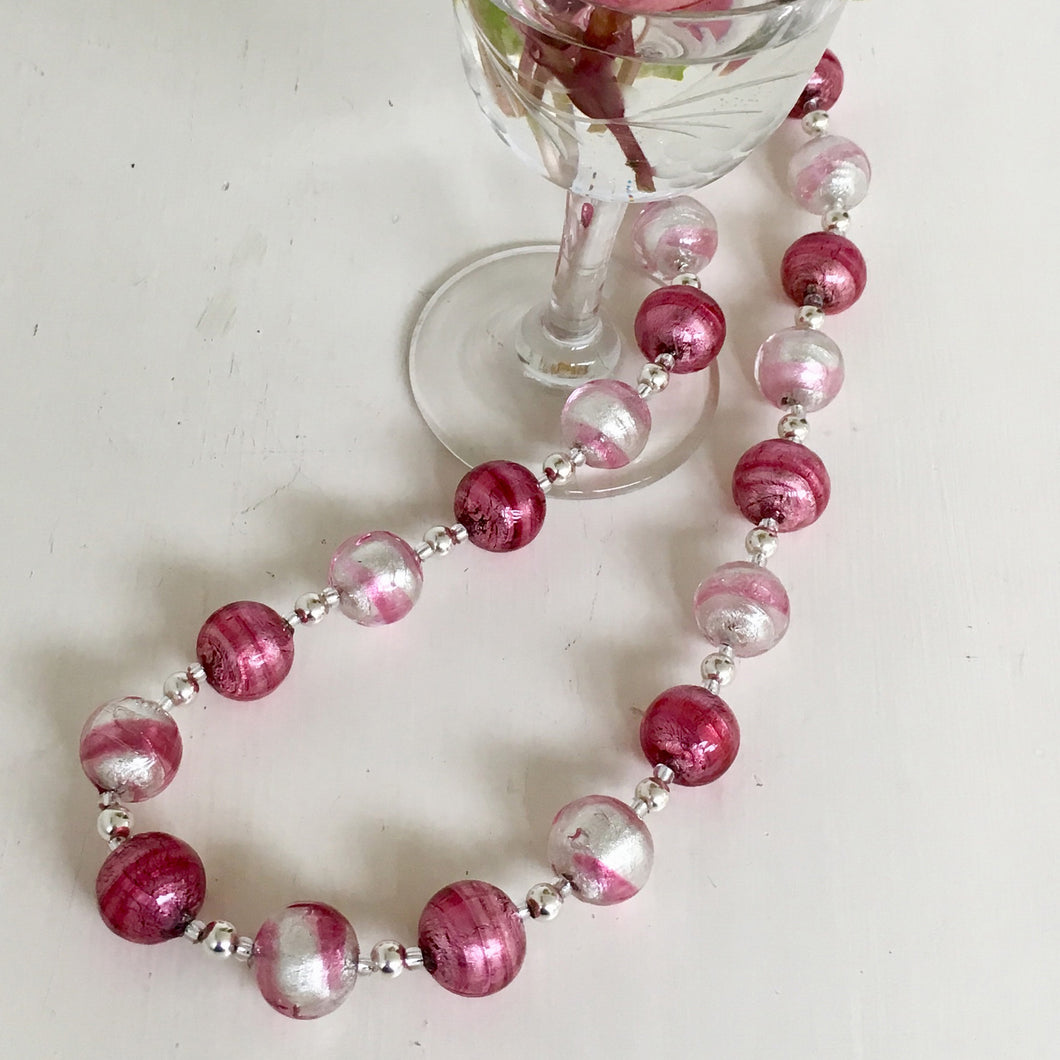 Necklace with rose pink and candy stripe pink Murano glass sphere beads on silver