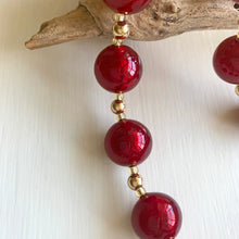 Necklace with red Murano glass sphere beads on gold beads and clasp