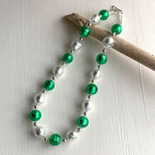Necklace with dark green (emerald) and clear crystal Murano glass sphere beads on silver