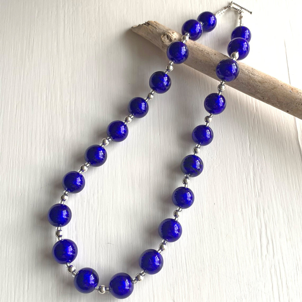 Necklace with dark blue (cobalt) Murano glass sphere beads on silver beads and clasp