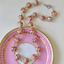 Necklace with pink appliqué over white gold Murano glass sphere beads on silver beads & clasp