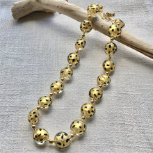 Necklace with gold and black spots Murano glass lentil beads on gold beads and clasp