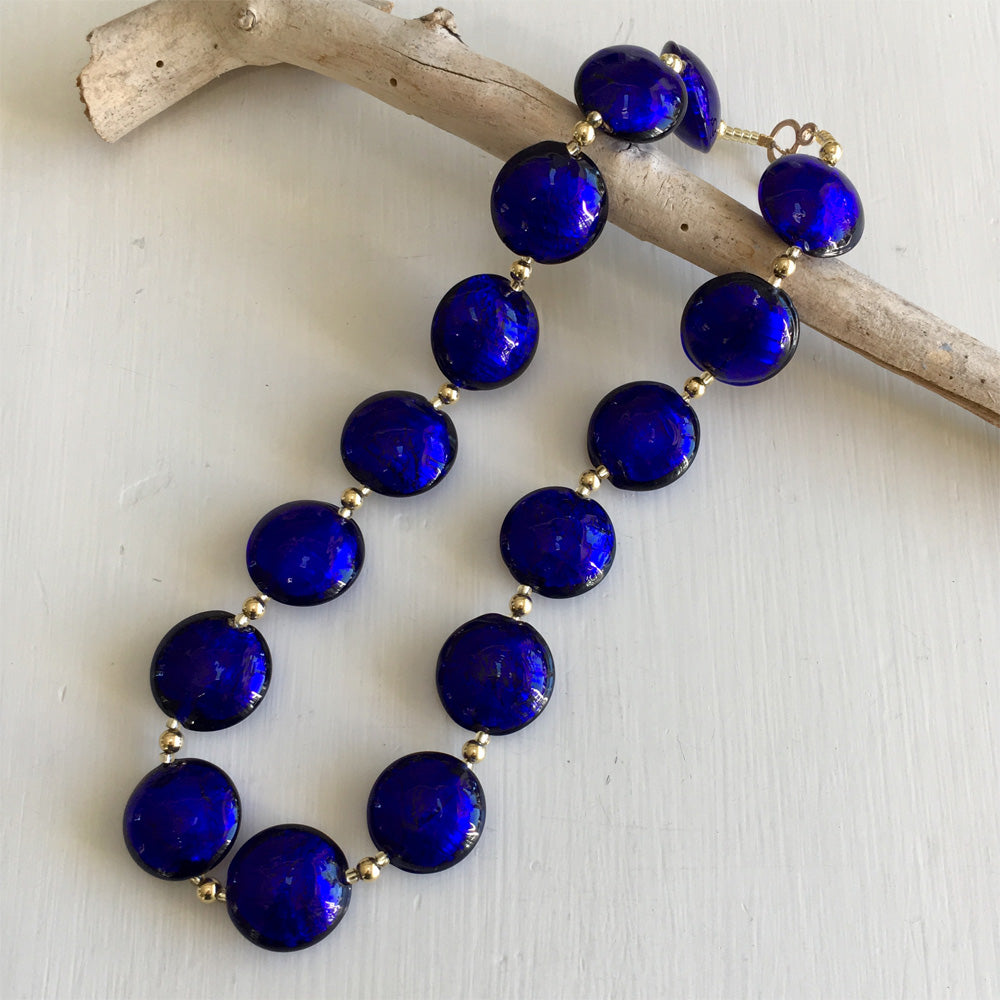 Necklace with dark blue (cobalt) Murano glass large lentil beads on gold beads and clasp
