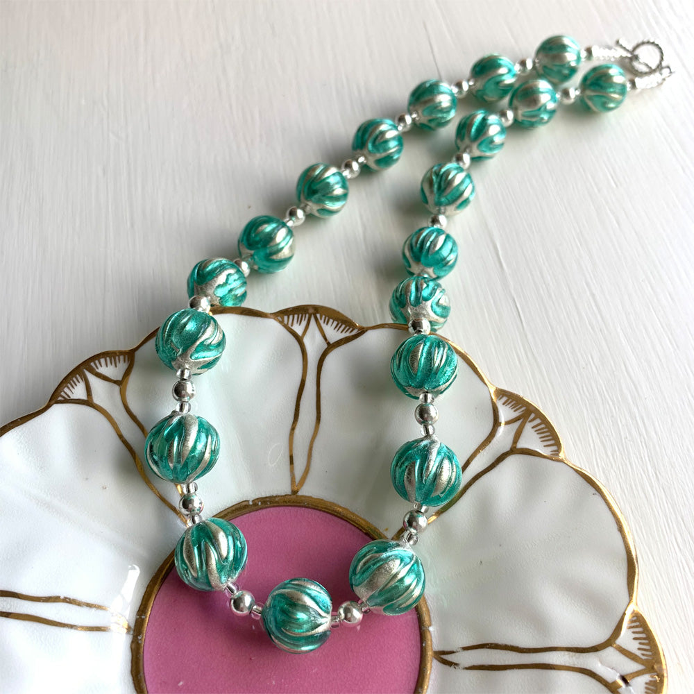 Necklace with teal (green, jade) appliqué over white gold Murano glass sphere beads on silver