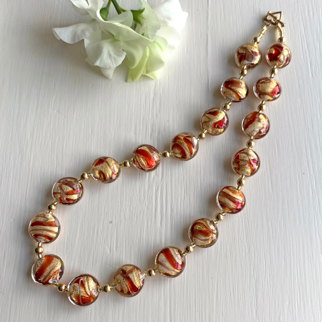 Necklace with red, gold dust, aventurine and white Murano glass medium lentil beads on gold