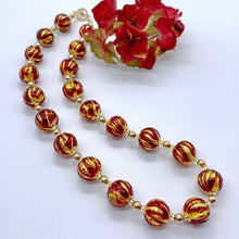 Necklace with red appliqué over gold Murano glass sphere beads on gold beads and clasp