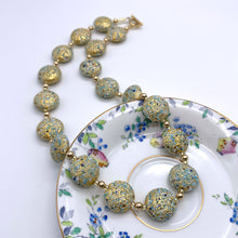 Necklace with speckled blues and white over gold Murano glass lentil beads on gold
