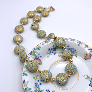 Necklace with speckled shades of blue and gold Murano glass large lentil beads on gold