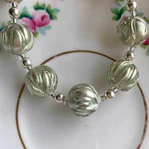 Necklace with grey appliqué over white gold Murano glass sphere beads on silver