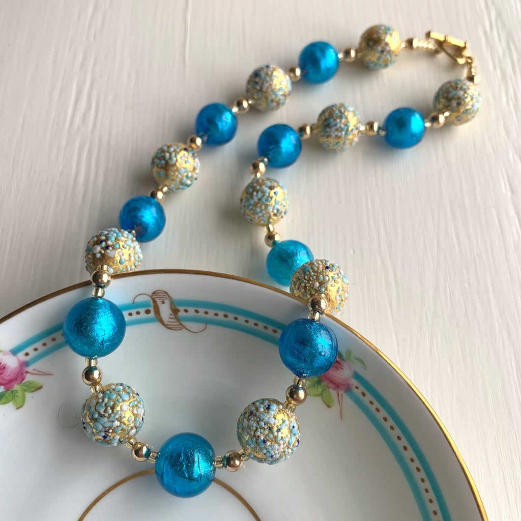 Necklace with speckled blues over gold and turquoise Murano glass sphere beads on gold